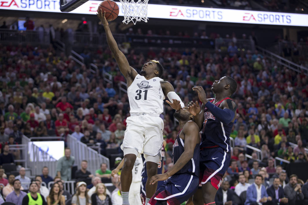 Oregon Ducks guard Dylan Ennis (31) shoots the ball for a score against Arizona Wildcats in an NCAA college basketball game for the Pac-12 tournament championship at T-Mobile Arena Saturday, March ...