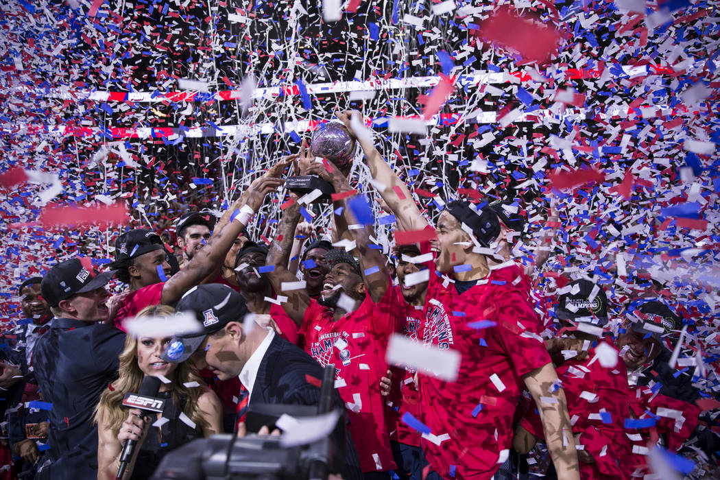 Arizona Wildcats players celebrate their win against Oregon Ducks in an NCAA college basketball game for the Pac-12 tournament championship at T-Mobile Arena Saturday, March 11, 2017, in Las Vegas ...
