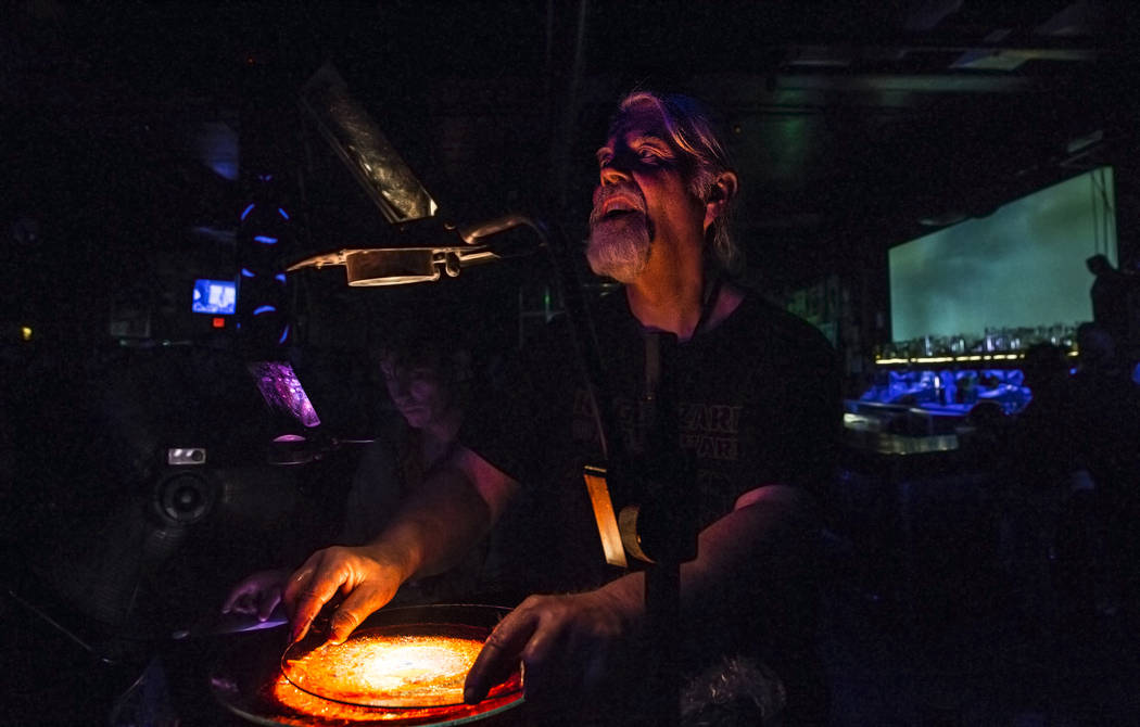 Glen Mckay directs Mad Alchemy light show during JJuuJJuu at the Neon Reverb music festival on Friday, March 10, 2017, at Backstage Bar & Billiards, in Las Vegas.  (Benjamin Hager/Las Vegas Re ...