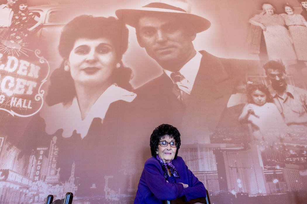 Maria Perry, who turns 100 on March 13, and Vegas Italian cooking icon, stands in her restaurant, Bootlegger Bistro, by a photo imprint of herself and her late husband, Albert Perry, Monday, March ...