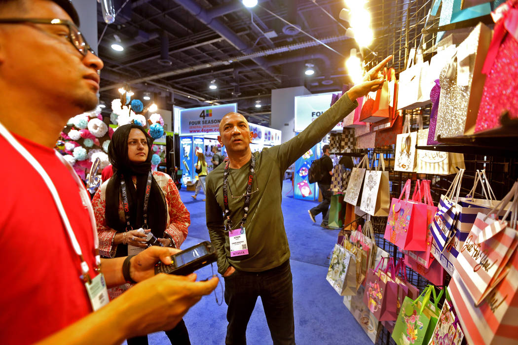 Ariel Molina, from left, talks to potential customers Uzma Adnan and Adnan Qadri at the booth of the Abi USA Sales Corp. during the ASD trade show on Sunday, March 19, 2017, at the Las Vegas Conve ...