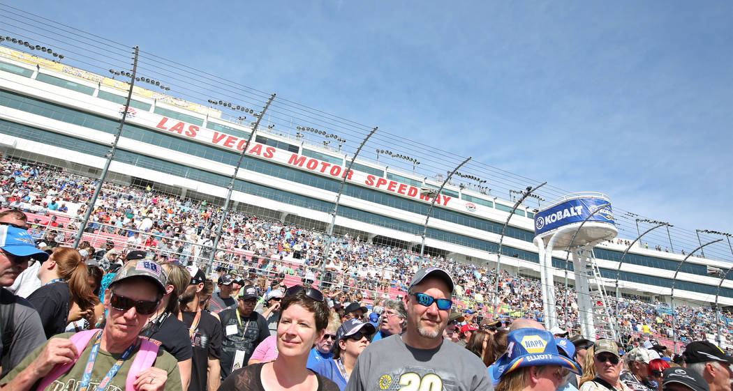 People gather during USAF Enlistment Ceremony before the Monster Energy NASCAR Cup Series Kobalt 400 auto race at Las Vegas Motor Speedway in Las Vegas, Sunday, March 12, 2017.  (Bridget Bennett / ...