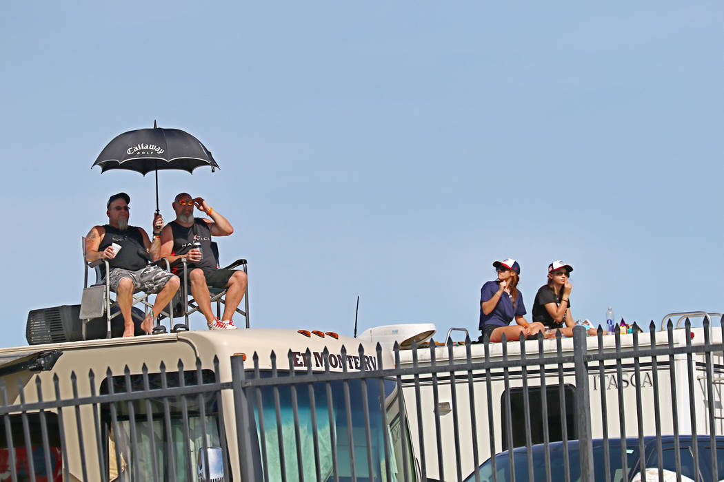 Fans atop RVs during the Monster Energy NASCAR Cup Series Kobalt 400 auto race  at Las Vegas Motor Speedway in Las Vegas, Sunday, March 12, 2017. (Miranda Alam  /Las Vegas Review-Journal)