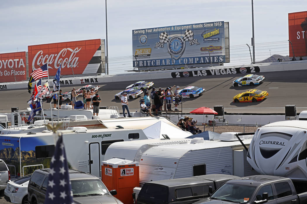 Fans atop RVs watch the Monster Energy NASCAR Cup Series Kobalt 400 auto race  at Las Vegas Motor Speedway in Las Vegas, Sunday, March 12, 2017. (Miranda Alam  /Las Vegas Review-Journal)