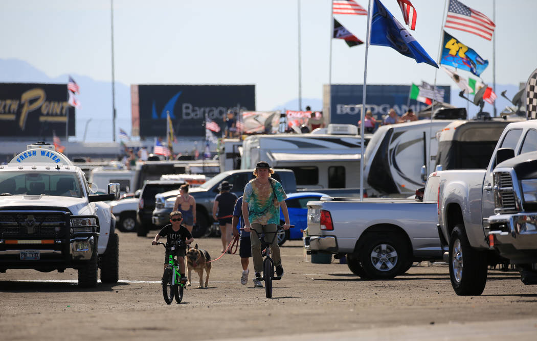 NASCAR fans ride bikes in the infield at the Monster Energy NASCAR Cup Series Kobalt 400 auto race at Las Vegas Motor Speedway in Las Vegas, Sunday, March 12, 2017. (Brett Le Blanc/Las Vegas Revie ...