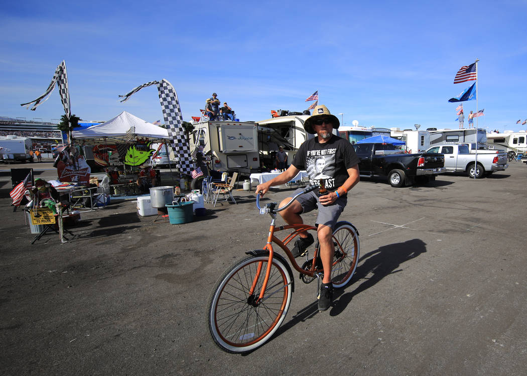 A fan rides his bike in the infield during the Monster Energy NASCAR Cup Series Kobalt 400 auto race at Las Vegas Motor Speedway in Las Vegas, Sunday, March 12, 2017. (Brett Le Blanc/Las Vegas Rev ...
