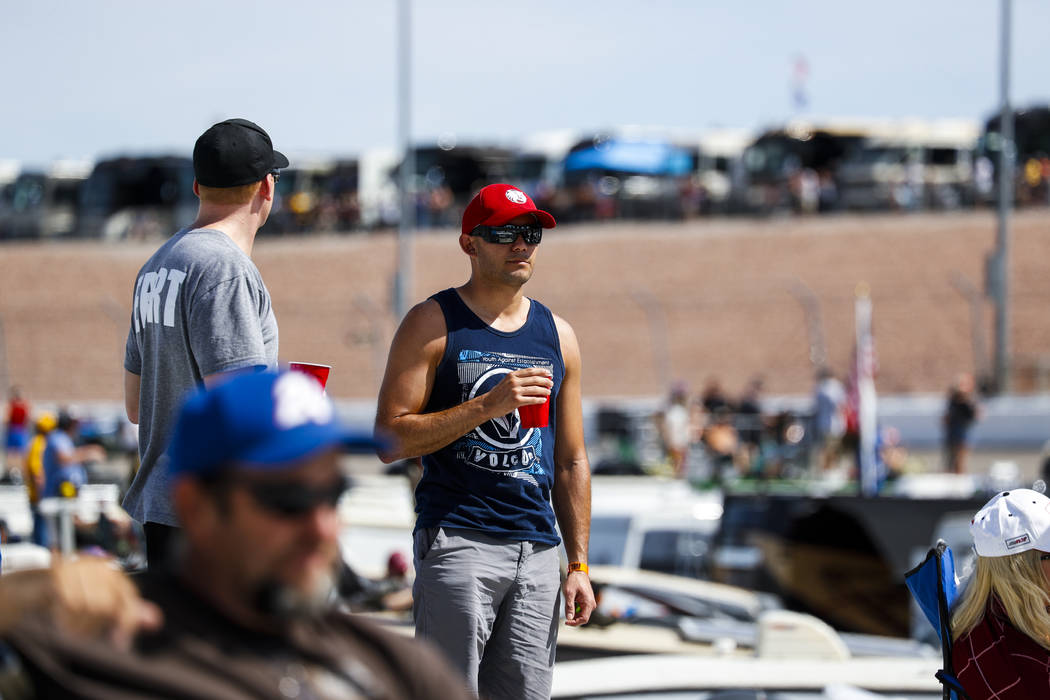 A fan watches from the top of a trailer during the Monster Energy NASCAR Cup Series Kobalt 400 auto race at Las Vegas Motor Speedway in Las Vegas  on Sunday, March 12, 2017. (Miranda Alam/Las Vega ...