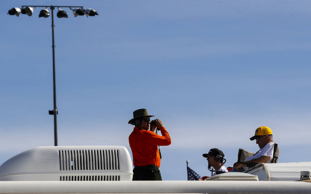 Fans watch from the top of a trailer before the Monster Energy NASCAR Cup Series Kobalt 400 auto race at Las Vegas Motor Speedway in Las Vegas  on Sunday, March 12, 2017. (Miranda Alam/Las Vegas R ...