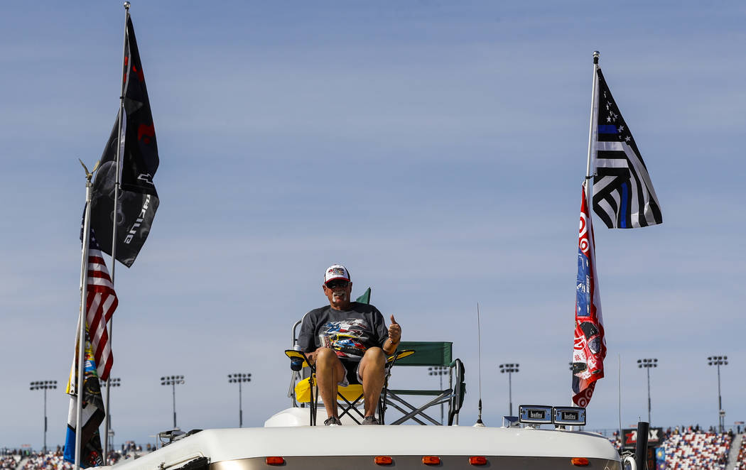 A fan watches from the top of a trailer before the Monster Energy NASCAR Cup Series Kobalt 400 auto race at Las Vegas Motor Speedway in Las Vegas  on Sunday, March 12, 2017. (Miranda Alam/Las Vega ...