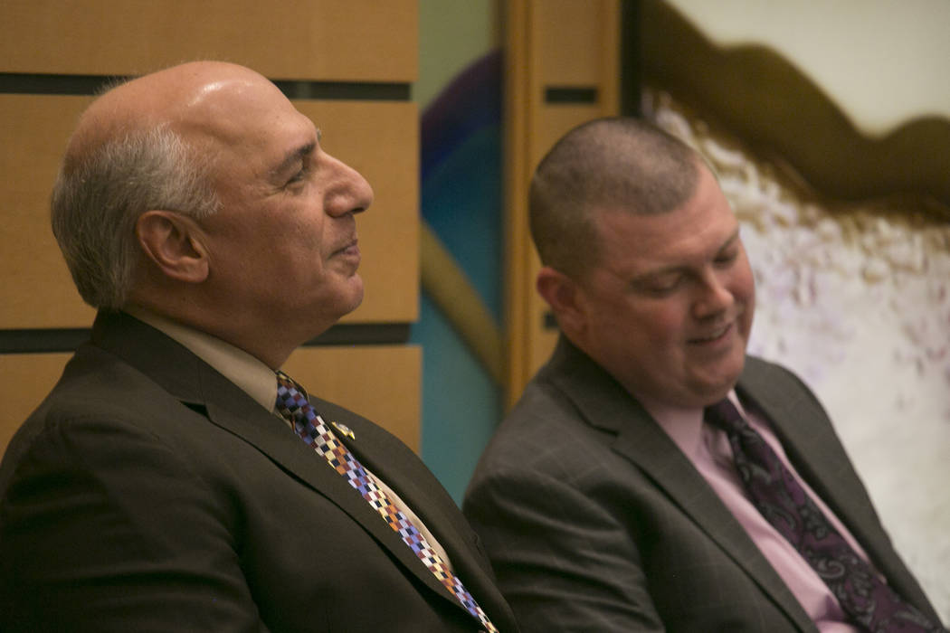 Las Vegas City Councilman representing Ward 4 Stavros Anthony and candidate for Las Vegas City Councilman representing Ward 4 Sean Lyttle listen while a question is asked during the debate at Temp ...