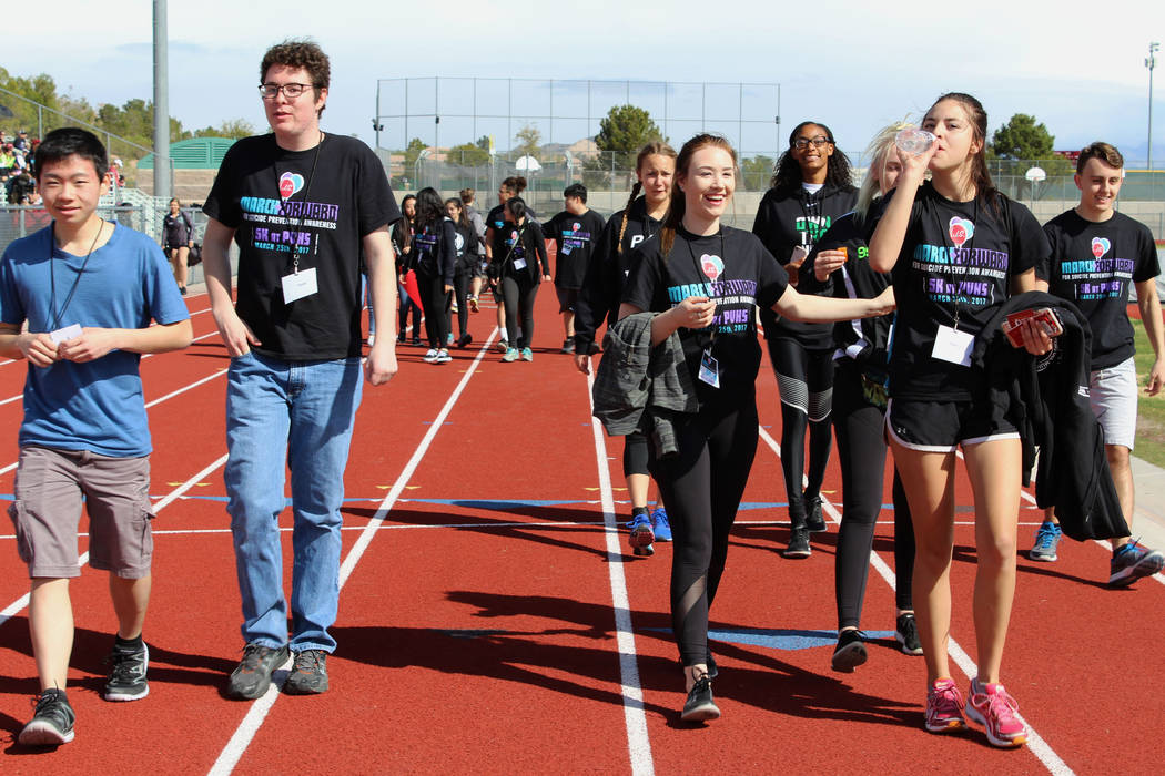 A group of Palo Verde High School students lead the way toward the starting point for the March Forward for Suicide Awareness 5K Walk, Saturday, March 25, 2017. (Gabriella Benavidez/Las Vegas Revi ...
