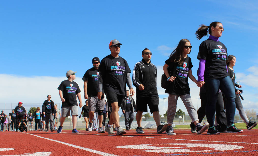 Community members make their way towards the starting point at Palo Verde High School for the March Forward for Suicide Awareness 5K Walk, Saturday, March 25, 2017. (Gabriella Benavidez/Las Vegas  ...