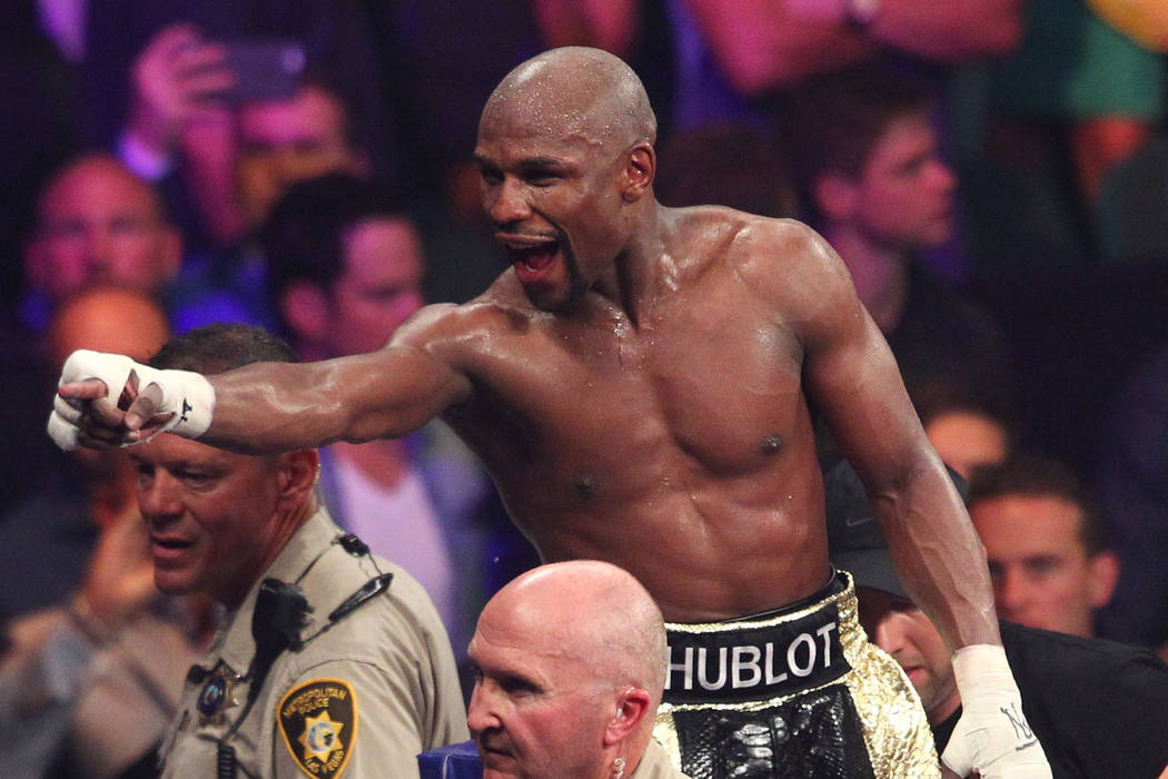 Floyd Mayweather Jr. acknowledges the crowd following his fight with Manny Pacquiao in their welterweight unification boxing match at the MGM Grand Garden Arena in Las Vegas on Saturday, May 2, 20 ...