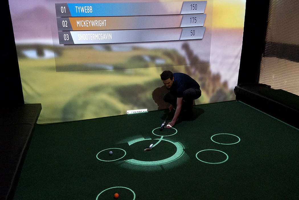 """Golfstream co-founder and chief financial officer Darren Dummit channels Chevy Chases's """"Caddyshack"""" character Ty Webb in a demonstration of a 30-second putting competition at the attraction's loc ..."""