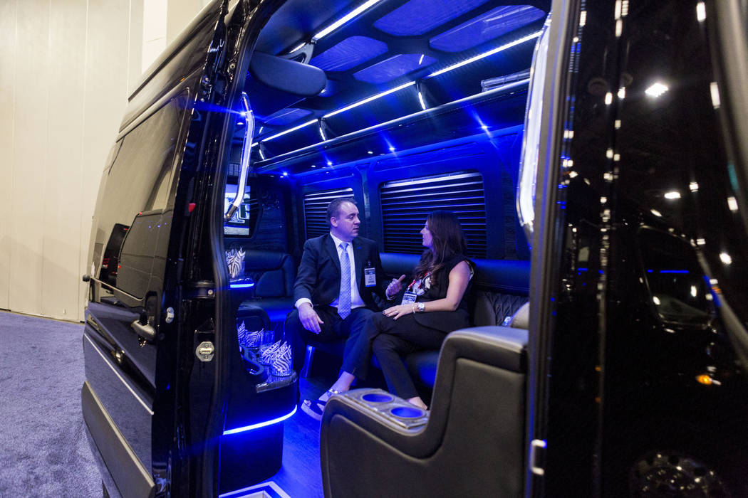 AJ Thurber of Grech Motors, left, and Tami Saccoccio of Commonwealth Worldwide Chauffeured Transportation, speak in a Grech Motors bus displayed at the International LCT Show at The Venetian and t ...
