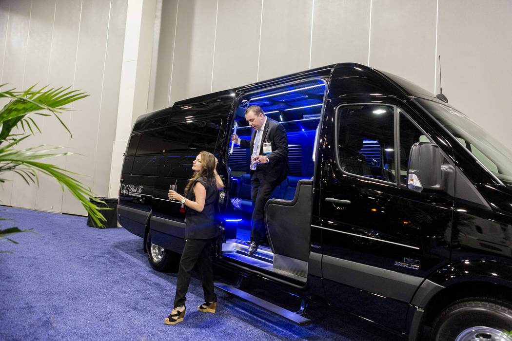 Tami Saccoccio of Commonwealth Worldwide Chauffeured Transportation, left, and AJ Thurber of Grech Motors, exit  a Grech Motors bus displayed at the International LCT Show at The Venetian and the  ...