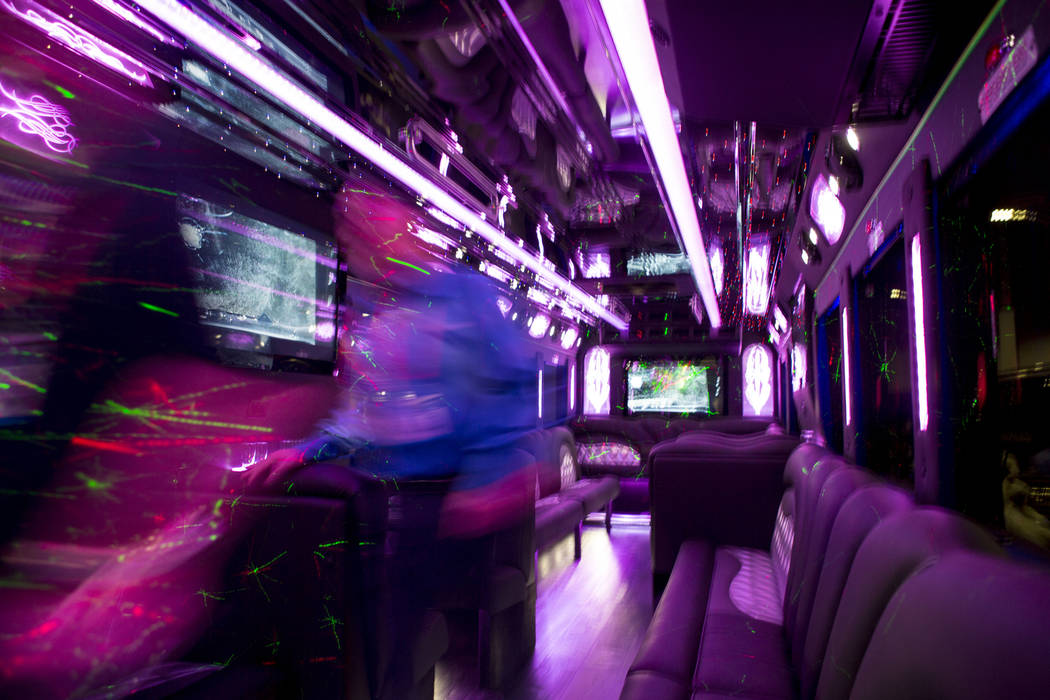 Attendees tour a luxury bus during the International LCT Show at The Venetian and the Palazzo in Las Vegas, Tuesday, March 14, 2017. (Elizabeth Brumley/Las Vegas Review-Journal) @EliPagePhoto