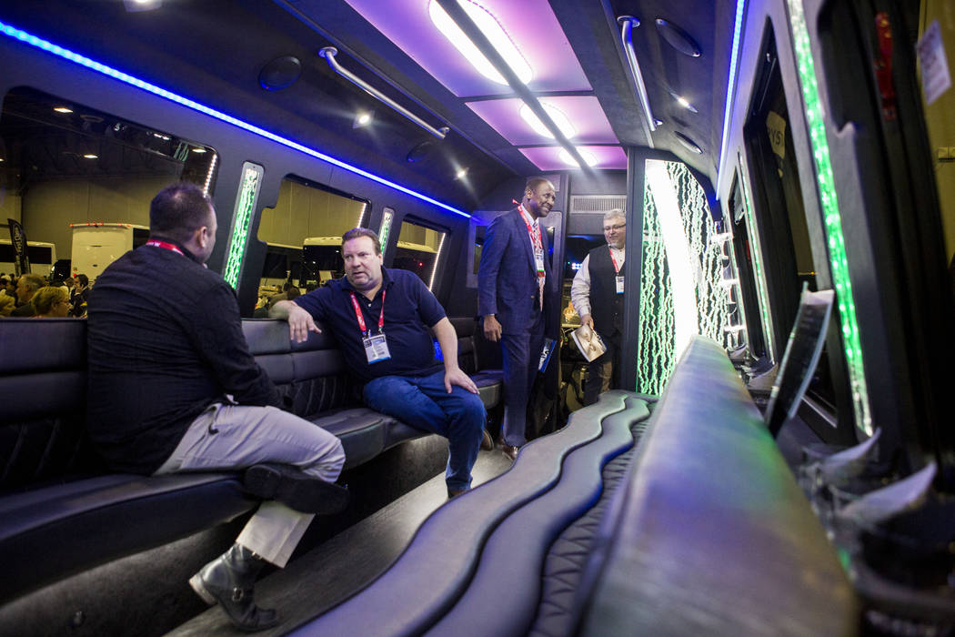 Attendees check out an LGE Coachworks' luxury bus during the International LCT Show at  the Venetian & Palazzo Resort Hotel Casinos in Las Vegas, Tuesday, March 14, 2017. (Elizabeth Brumley/La ...