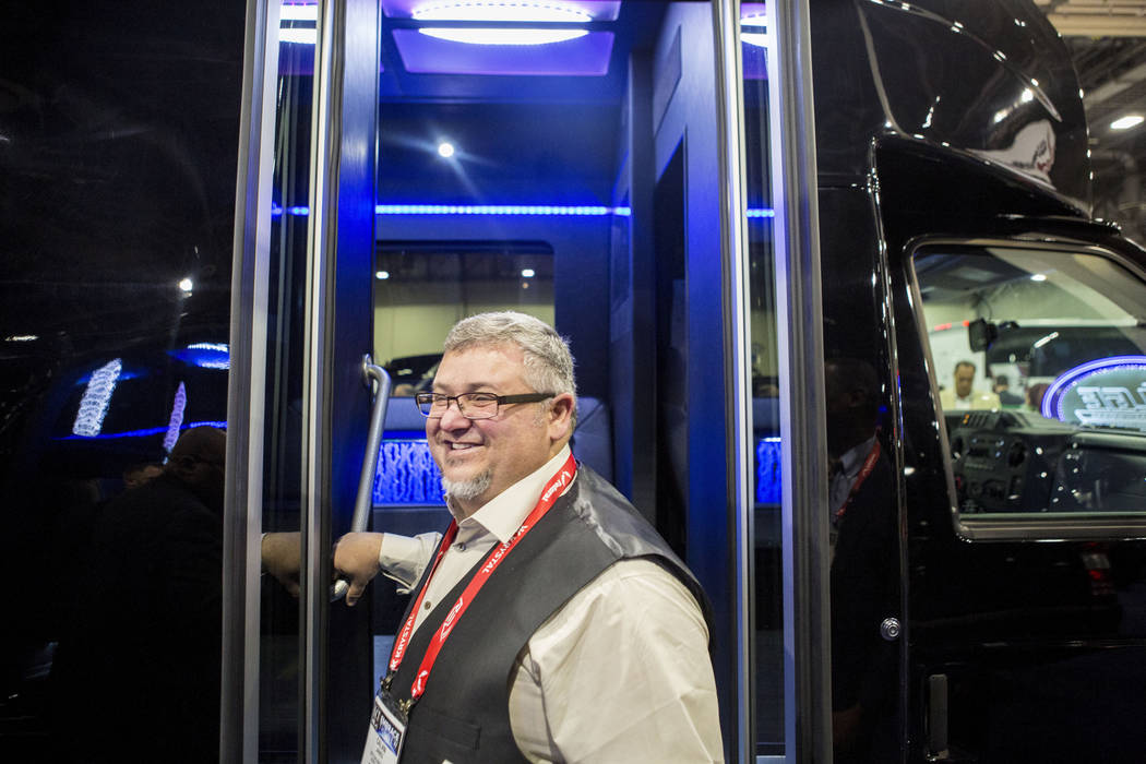 Calvin Janes of LGE Coachworks INC., leaves a luxury bus displayed at the International LCT Show at the International LCT Show at The Venetian and the Palazzo in Las Vegas, Tuesday, March 14, 2017 ...