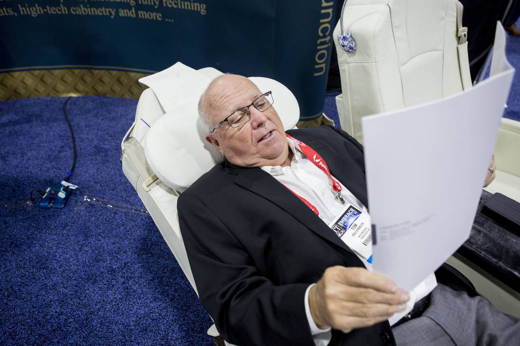 Tom Hollenbeck of Nations Bus, tries out a luxury seat during the International LCT Show at the International LCT Show at The Venetian and the Palazzo in Las Vegas, Tuesday, March 14, 2017. (Eliza ...