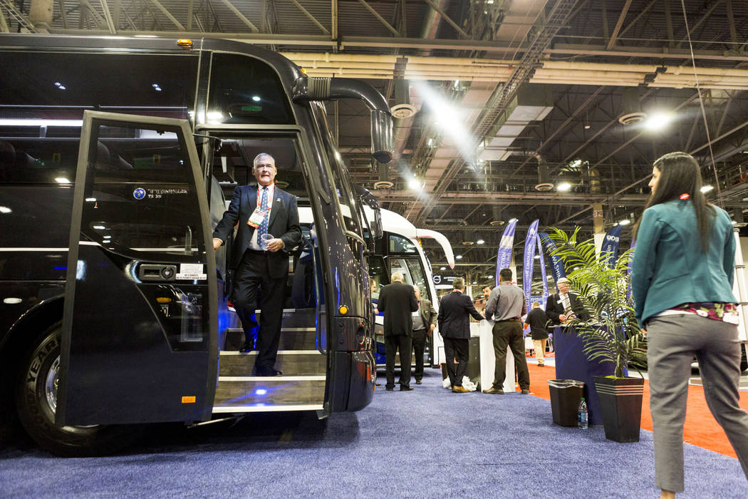 John Critchett of Palm Beach Tours & Transportation exits a luxury coach bus on display at the International LCT Show at the International LCT Show at The Venetian and the Palazzo in Las Vegas ...