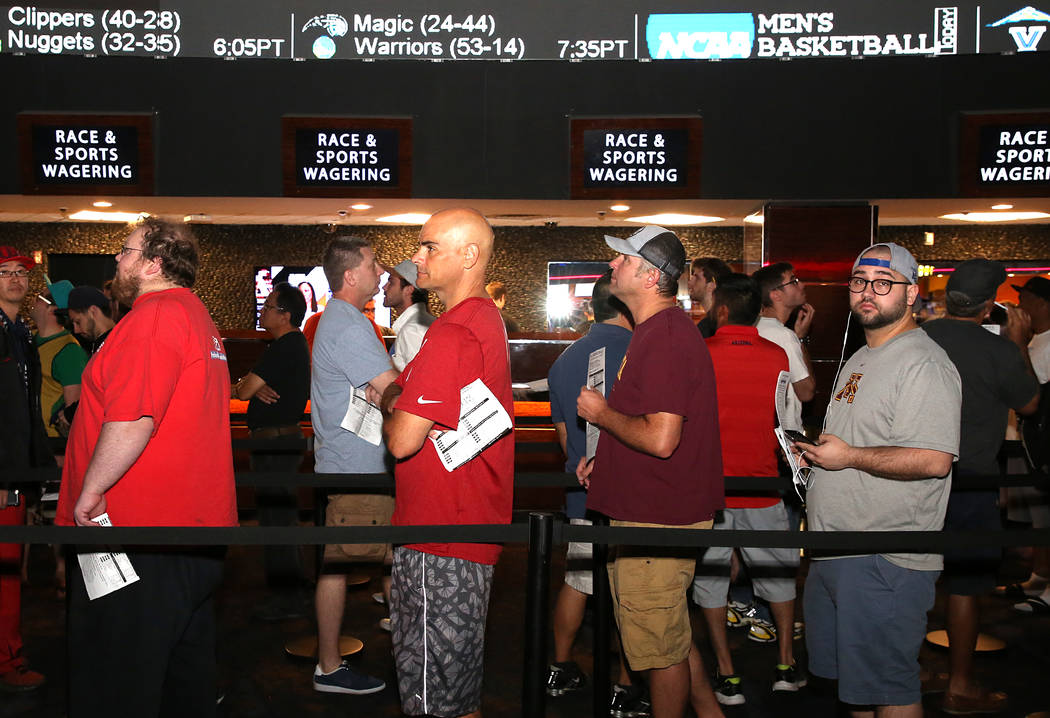 People wait in line to bet on the NCAA basketball tournament at Westgate sports book on Thursday, March 16, 2017, in Las Vegas. (Bizuayehu Tesfaye/Las Vegas Review-Journal) @bizutesfaye
