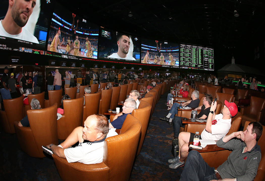 People watch the NCAA basketball tournament at Westgate sports book on Thursday, March 16, 2017, in Las Vegas. (Bizuayehu Tesfaye/Las Vegas Review-Journal) @bizutesfaye