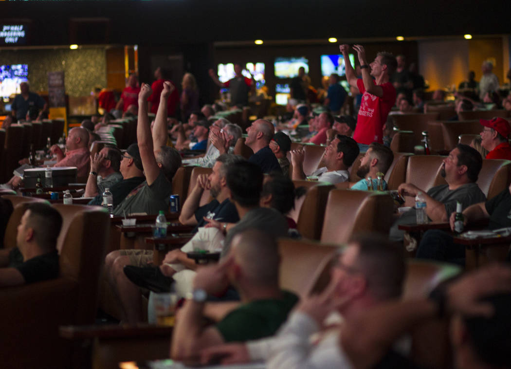 Basketball fans react as Northwestern defeats Vanderbilt during the first day of the NCAA basketball tournament at the Westgate sports book in Las Vegas on Thursday, March 16, 2017. (Chase Stevens ...