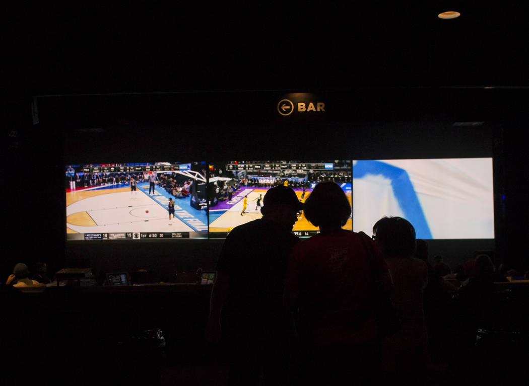 Basketball fans arrive at the International Westgate Theater to take in the action from the first day of the NCAA basketball tournament in Las Vegas on Thursday, March 16, 2017. (Chase Stevens/Las ...