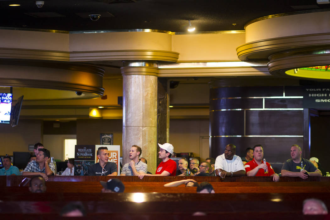 Basketball fans take in the action during the first day of the NCAA basketball tournament at the Westgate sports book in Las Vegas on Thursday, March 16, 2017. (Chase Stevens/Las Vegas Review-Jour ...