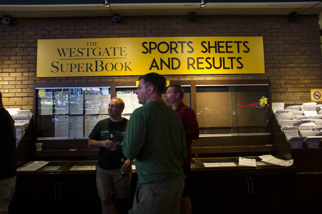 Fans take in the action during the first day of the NCAA basketball tournament at the Westgate sports book in Las Vegas on Thursday, March 16, 2017. (Chase Stevens/Las Vegas Review-Journal) @csste ...