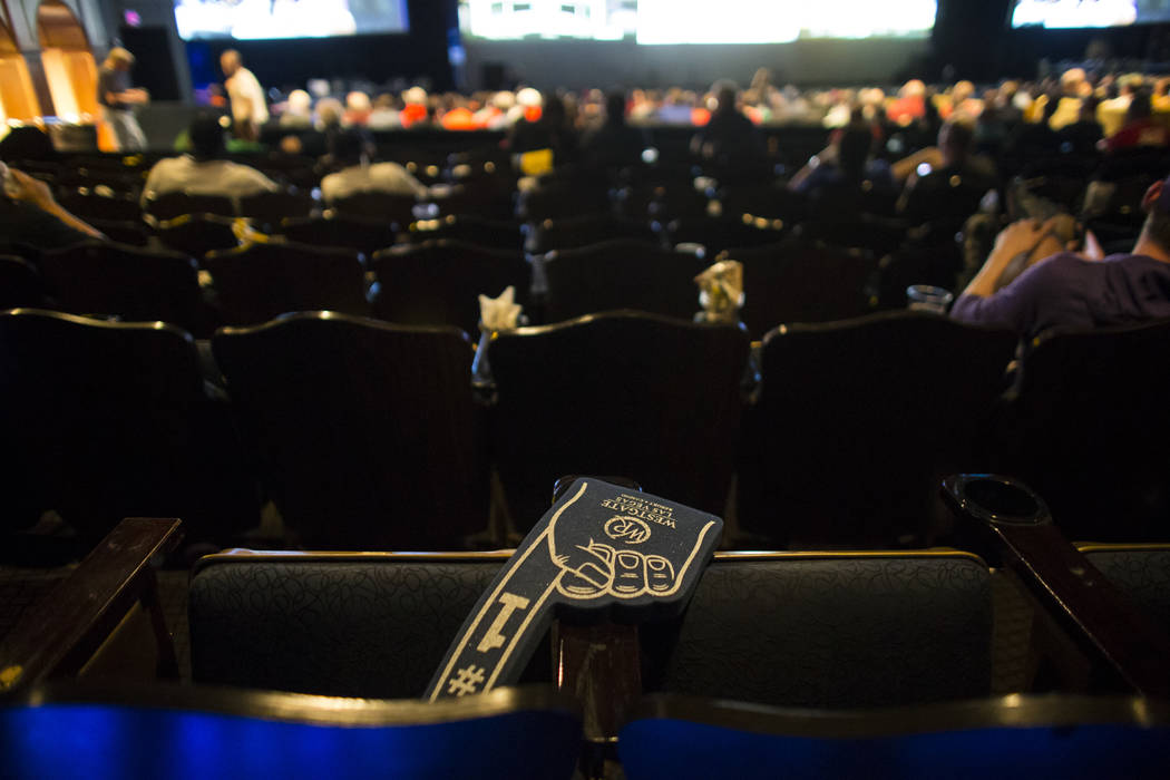 A foam finger is left behind as basketball fans watch the action during the first day of the NCAA basketball tournament at the International Westgate Theater in Las Vegas on Thursday, March 16, 20 ...