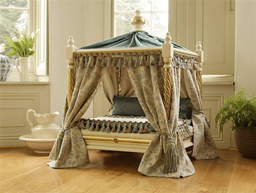 COURTESY This four-poster canopy bed is fit for a queen, but it's actually