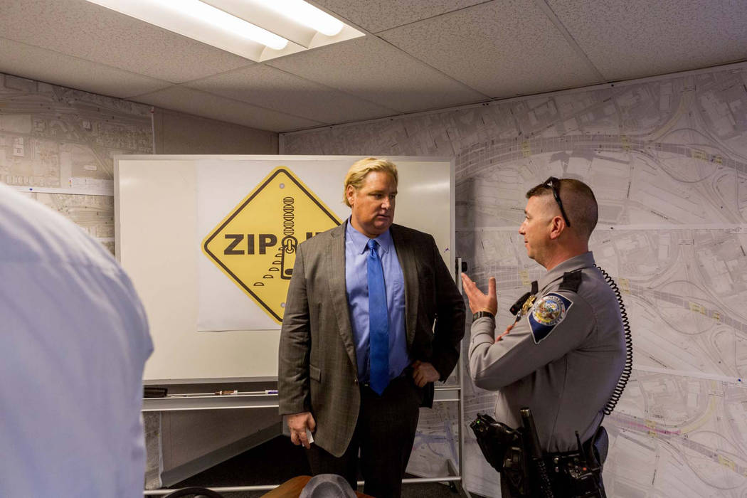 "Tony Illia, public information officer for the Nevada Department of Transportation, left, and Trooper Jason Buratczuk discuss updates for the ""Big Squeeze,"" the second of three major ..."