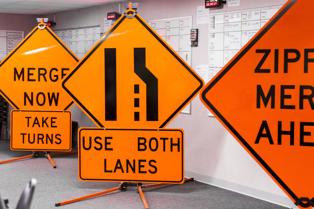 "Road signs that will be in use starting Monday, March 21, 2017, when the ""Big Squeeze"" construction begins as the second phase of Project Neon, at the Project Neon office in Las Vega ..."