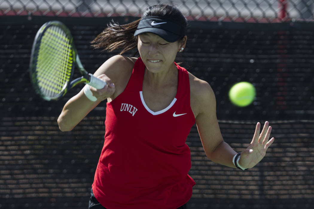 UNLV tennis player Carol Zi Yang hits the ball in her match against Washington State at UNLV on Wednesday, March 15, 2017, in Las Vegas. (Erik Verduzco/Las Vegas Review-Journal) @Erik_Verduzco