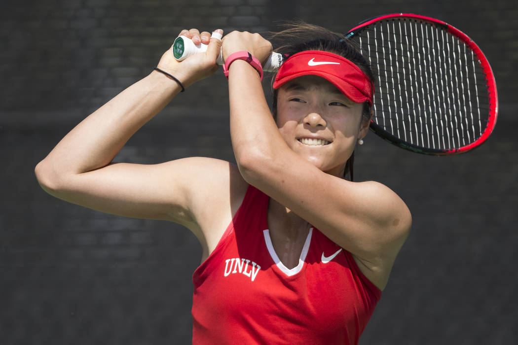 UNLV tennis player Aiwen Zhu after hitting the ball in her match against Washington State at UNLV on Wednesday, March 15, 2017, in Las Vegas. (Erik Verduzco/Las Vegas Review-Journal) @Erik_Verduzco