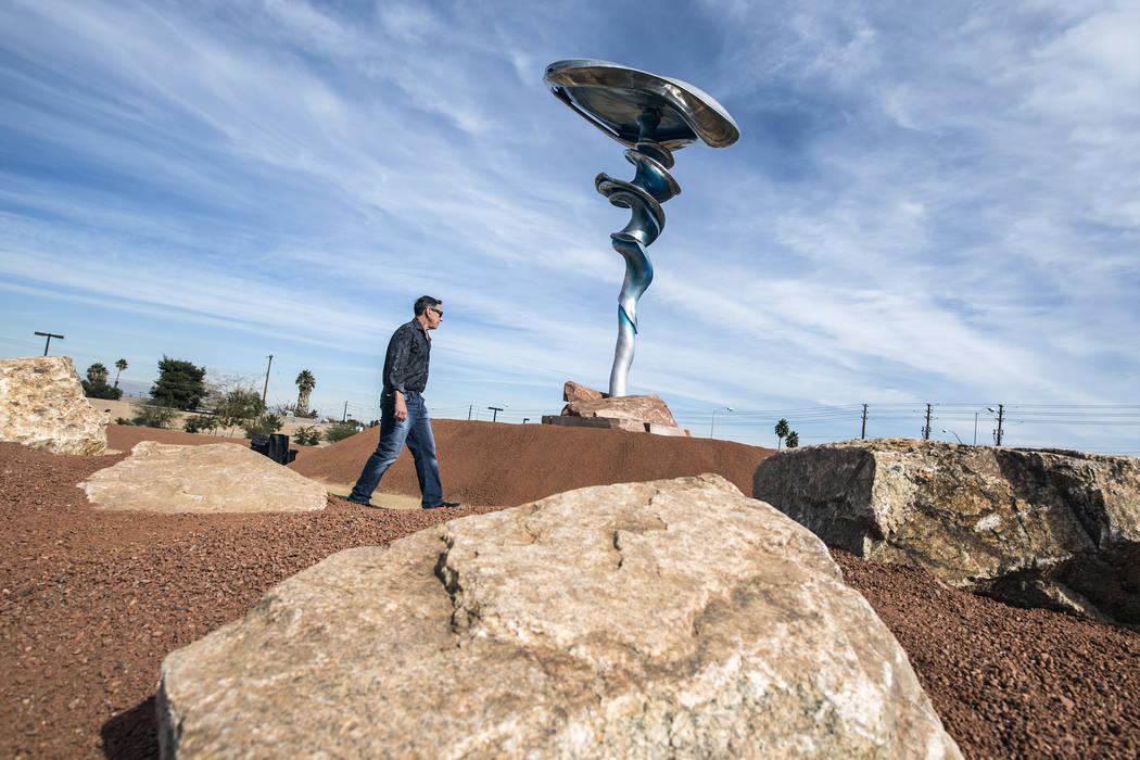 """Artist Wayne Littlejohn walks near the sculpture he created called """"Dream Machine,"""" during an art installment dedication at Siegfried & Roy Park across the street from McCarran International A ..."""