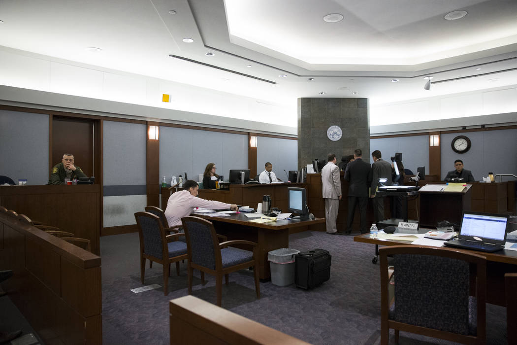 War Machine, left, also known as Jonathan Koppenhaver, who faces rape, attempted murder and kidnapping charges, during his trial at the Regional Justice Center on Tuesday, March 14, 2017, in Las V ...