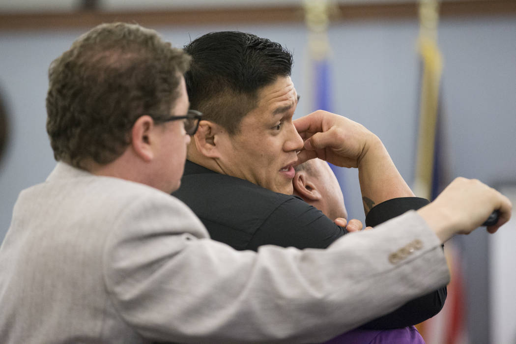 Mixed martial artist Herman Terrado, center, shows the difference between various chokeholds during the trial for War Machine, also known as Jonathan Koppenhaver, who faces rape, attempted murder  ...