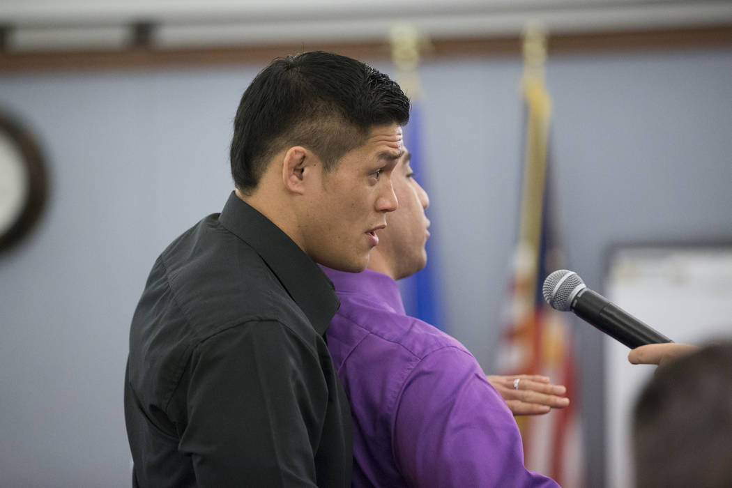 Mixed martial artist Herman Terrado, left, with defense attorney Brandon Sua, shows the difference between various chokeholds during the trial for War Machine, also known as Jonathan Koppenhaver,  ...