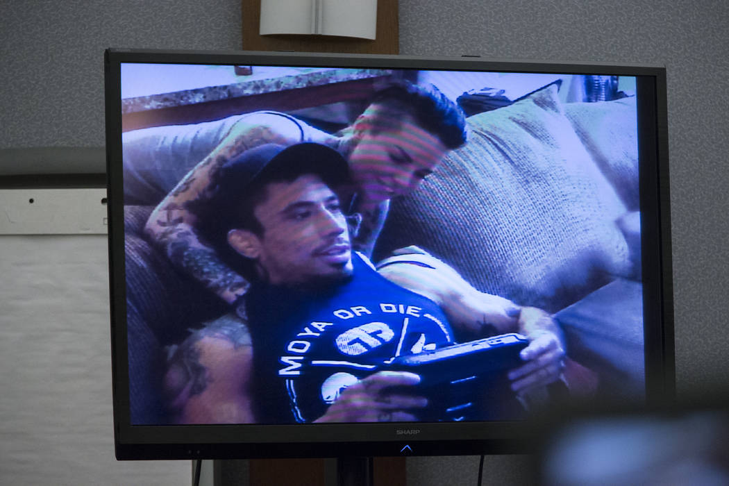 A picture of War Machine, also known as Jonathan Koppenhaver, with his ex-girlfriend Christine Mackinday, who faces rape, attempted murder and kidnapping charges, during his trial at the Regional  ...