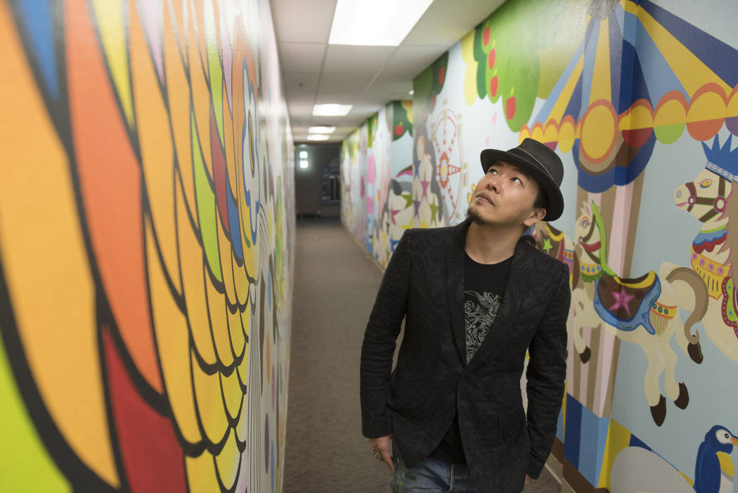 "Artist Sush Machida gives a tour of his mural entitled ""Hope Corridor"" at Child Haven at the Clark County Family Services Department in Las Vegas Monday, March 7, 2016. (Jason Ogulnik/Las Vegas Re ..."