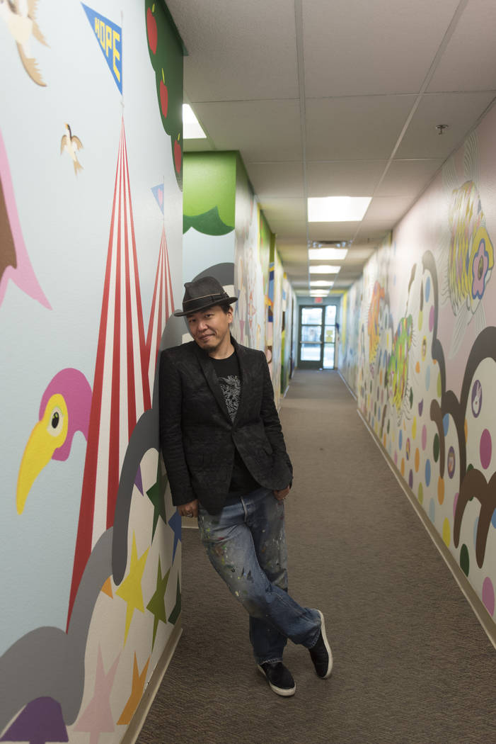 "Artist Sush Machida poses with his mural entitled ""Hope Corridor"" at Child Haven at the Clark County Family Services Department in Las Vegas Monday, March 7, 2016. (Jason Ogulnik/Las Vegas Review- ..."
