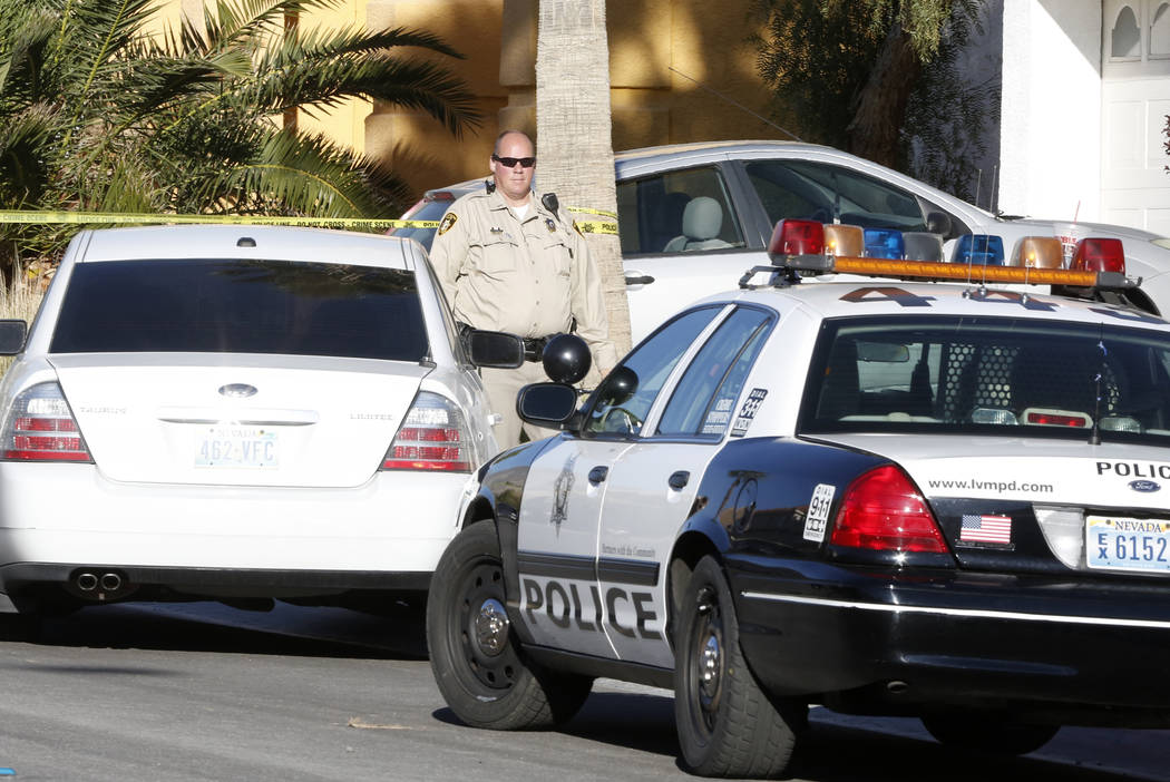 Las Vegas police investigate the shooting death of a man at 8521 Hesperides Ave. on Tuesday, March 14, 2017, in Las Vegas. (Bizuayehu Tesfaye/Las Vegas Review-Journal) @bizutesfaye
