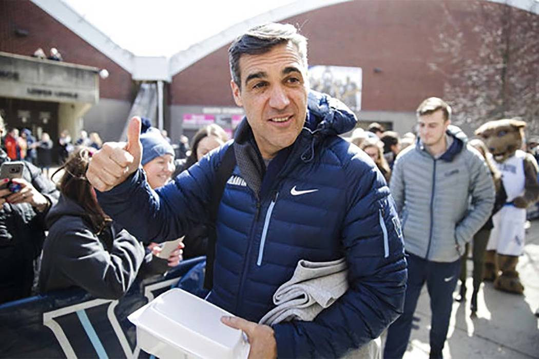 Villanova head coach Jay Wright gestures before boarding a bus as the team departs on Monday, March 13, 2017, for a game in the first round of the NCAA Tournament, in Buffalo, N.Y. Teams chasing a ...