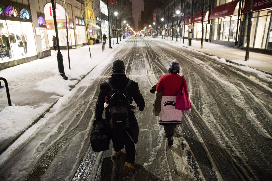 A couple walks in the street during a winter storm in Philadelphia, Tuesday, March 14, 2017. (Matt Rourke/AP)