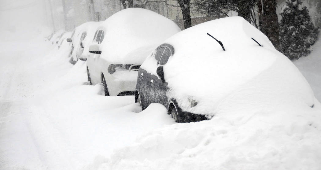 Cars parked on East Green Street in Hazleton, Pa., are buried as heavy snowfall moves through the area leaving more than a foot of snow, Tuesday, March 14, 2017. (Ellen F. O'Connell/Hazleton Stand ...