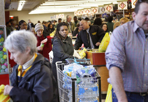 A grocery store is filled with shoppers stocking up on food and other supplies in Paramus, New Jersey,  Monday, March 13, 2017. The Northeast is bracing for a blizzard expected to sweep the New Yo ...