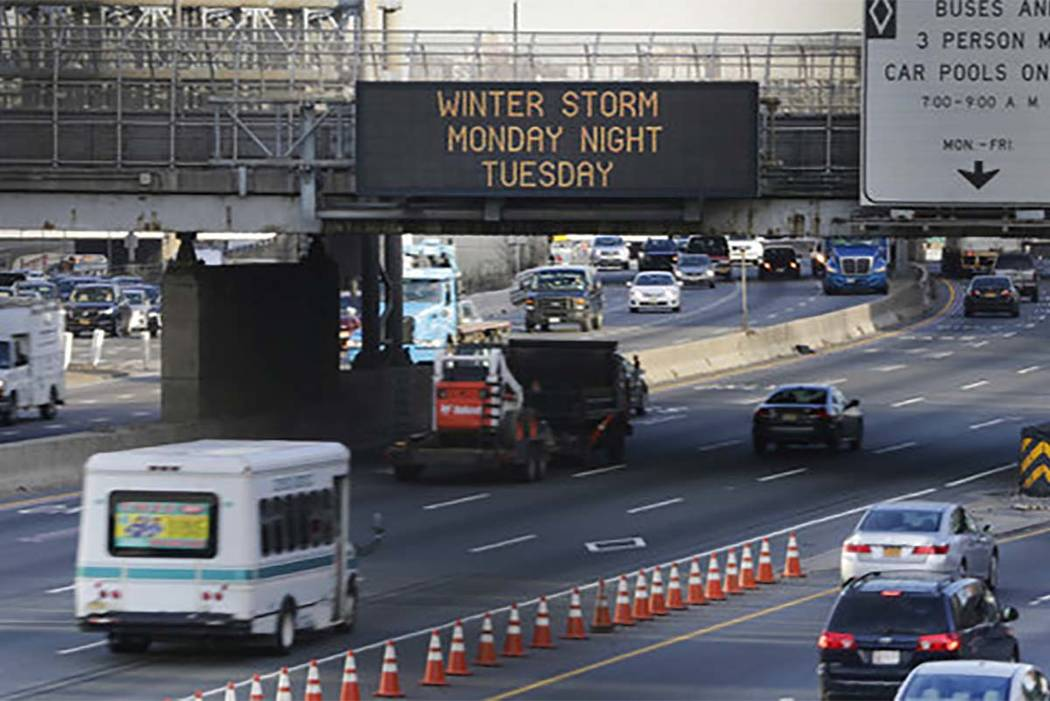 A sign warns motorists about an impending winter storm in Fort Lee, New Jersey, Monday, March 13, 2017. The Northeast is bracing for a blizzard expected to sweep the New York region with possibly  ...